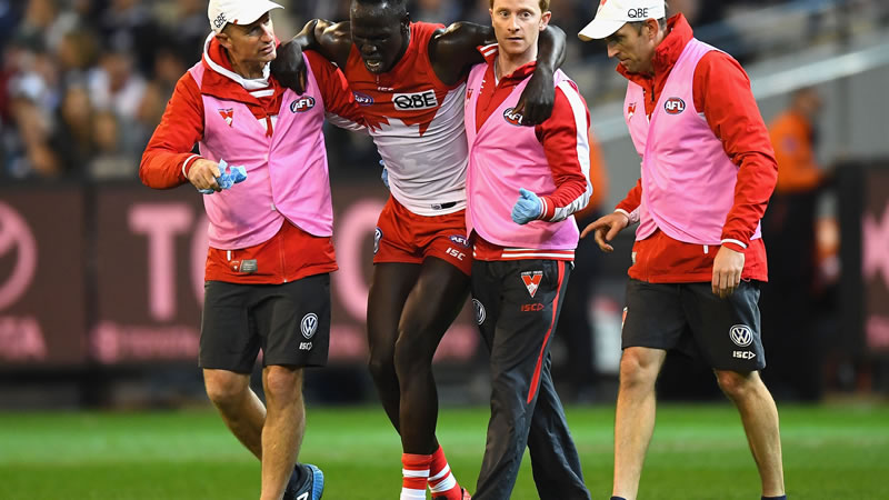 Sydney Swans defender Aliir Aliir goes a medial ligament in his knee - assisted by Tim Needham