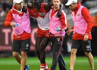 Sydney Swans defender Aliir Aliir goes a medial ligament in his knee - assisted by Senior Physio Tim Needham